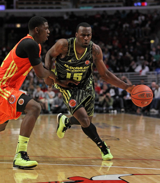 CHICAGO, IL - MARCH 28:  MVP Shabazz Muhammad #15 of the West team drives against Alex Poythress #22 of the East team during the 2012 McDonald's All American Game at United Center on March 28, 2012 in Chicago, Illinois.  (Photo by Jonathan Daniel/Getty Images)