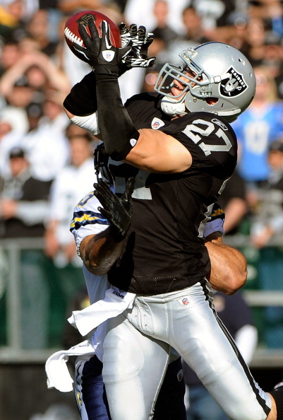 OAKLAND, CA - JANUARY 01:  Matt Giordano #27 of the Oakland Raiders intercepts a pass against the San Diego Chargers at O.co Coliseum on January 1, 2012 in Oakland, California.  (Photo by Thearon W. Henderson/Getty Images)