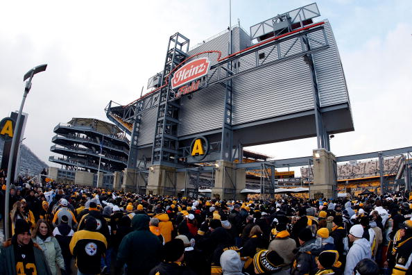 PITTSBURGH - JANUARY 11:  Fans line up outside of Heinz Field as they wait to enter the stadium for the AFC Divisional Playoff Game between the Pittsburgh Steelers and the San Diego Chargers  on January 11, 2009 at Heinz Field in Pittsburgh, Pennsylvania.  (Photo by Gregory Shamus/Getty Images)