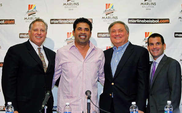MIAMI GARDENS, FL - SEPTEMBER 28:  (L to R) Florida Marlins President of Baseball Operations Larry Beinfest , Ozzie Guillen , Florida Marlins owner Jeffrey Loria  and Florida Marlins President David P. Samson attend a press conference to announce Guillen as the new manage at Sun Life Stadium on September 28, 2011 in Miami Gardens, Florida.  (Photo by Mike Ehrmann/Getty Images)
