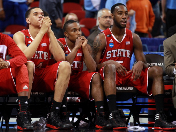 ST. LOUIS, MO - MARCH 23:  (L-R) Jordan Vandenberg #14, Alex Johnson #3 and C.J. Leslie #5 of the North Carolina State Wolfpack sit dejected on the bench in the second half against the Kansas Jayhawks during the 2012 NCAA Men's Basketball Midwest Regional Semifinal at Edward Jones Dome on March 23, 2012 in St. Louis, Missouri.  (Photo by Andy Lyons/Getty Images)