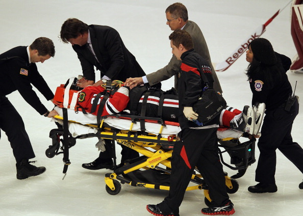 CHICAGO, IL - APRIL 17: Marian Hossa #81 of the Chicago Blackhawks is moved off of the ice on a stretcher following a collison against the Phoenix Coyotes in Game Three of the Western Conference Quarterfinals during the 2012 NHL Stanley Cup Playoffs at the United Center on April 17, 2012 in Chicago, Illinois. (Photo by Jonathan Daniel/ Getty Images)