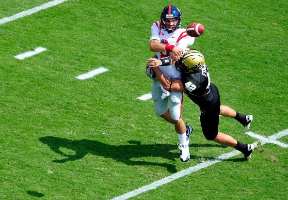 NASHVILLE, TN - SEPTEMBER 17:  Tim Fugger #42 of the Vanderbilt Commodores pressures quarterback Zack Stoudt #8 of the Ole Miss Rebels at Vanderbilt Stadium on September 17, 2011 in Nashville, Tennessee.  (Photo by Grant Halverson/Getty Images)