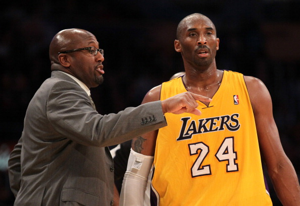 LOS ANGELES, CA - DECEMBER 27:  Kobe Bryant #24 of the Los Angeles Lakers confers with head coach Mike Brown during the game against the Utah Jazz at Staples Center on December 27, 2011 in Los Angeles, California.  The Lakers won 96-71. NOTE TO USER: User expressly acknowledges and agrees that, by downloading and or using this photograph, User is consenting to the terms and conditions of the Getty Images License Agreement.  (Photo by Stephen Dunn/Getty Images)
