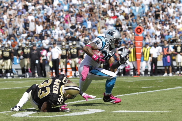 CHARLOTTE, NC - OCTOBER 9: Steve Smith #89 of the Carolina Panthers catches a 54-yard touchdown pass in the first quarter against Jabari Greer #33 of the New Orleans Saints at Bank of America Stadium on October 9, 2011 in Charlotte, North Carolina. (Photo by Joe Robbins/Getty Images)