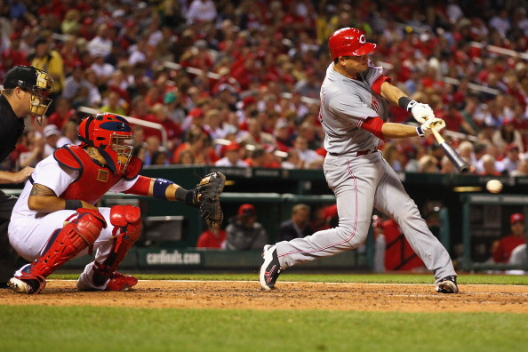 ST. LOUIS, MO - APRIL 18: Devin Mesoraco #39 of the Cincinnati Reds hits an RBI single against the St. Louis Cardinals at Busch Stadium on April 18, 2012 in St. Louis, Missouri.  (Photo by Dilip Vishwanat/Getty Images)