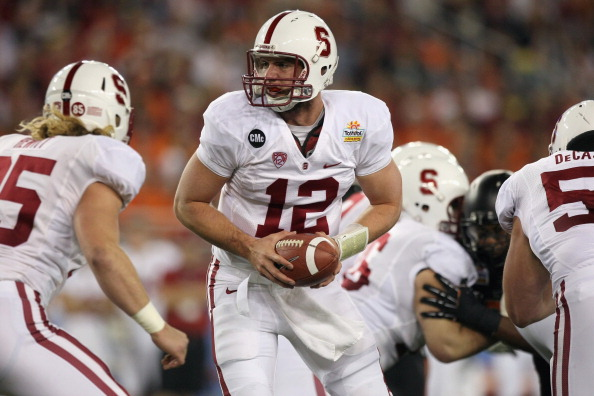 GLENDALE, AZ - JANUARY 02:  Andrew Luck #12 of the Stanford Cardinal turns to hand the ball off against the Oklahoma State Cowboys during the Tostitos Fiesta Bowl on January 2, 2012 at University of Phoenix Stadium in Glendale, Arizona.  (Photo by Donald Miralle/Getty Images)