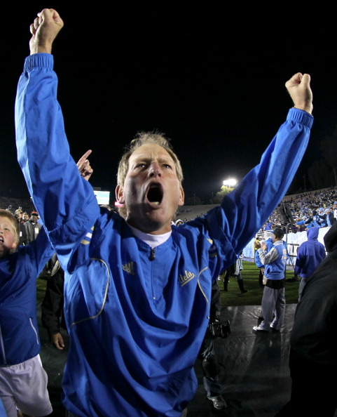 PASADENA, CA - NOVEMBER 05:  Head coach Rick Neuheisel of the UCLA Bruins celebrates as he leaves the field after the game against the Arizona State Sun Devils at the Rose Bowl on November 5, 2011 in Pasadena, California. UCLA won 29-28.  (Photo by Stephen Dunn/Getty Images)