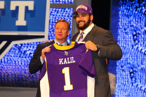 NEW YORK, NY - APRIL 26:  Matt Kalil (R) from USC holds up a jersey as he stands on stage with NFL Commissioner Roger Goodell after he was selected #4 overall by the Minnesota Vikings in the first round of the 2012 NFL Draft at Radio City Music Hall on April 26, 2012 in New York City.  (Photo by Al Bello/Getty Images)