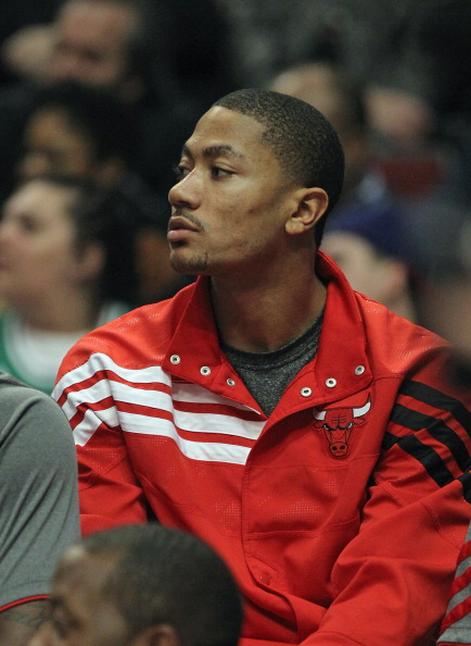 CHICAGO, IL - APRIL 26:  Derrick Rose #1 of the Chicago Bulls watches from the bench as his teammates take on the Cleveland Cavaliers at the United Center on April 26, 2012 in Chicago, Illinois. NOTE TO USER: User expressly acknowledges and agrees that, by downloading and or using this photograph, User is consenting to the terms and conditions of the Getty Images License Agreement.  (Photo by Jonathan Daniel/Getty Images)