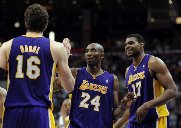 LOS ANGELES, CA - APRIL 04:  Kobe Bryant #24 of the Los Angeles Lakers celebrates with Andrew Bynum #17 and Pau Gasol #16 during the game against the Los Angeles Clippers at Staples Center on April 4, 2012 in Los Angeles, California.  NOTE TO USER: User expressly acknowledges and agrees that, by downloading and or using this photograph, User is consenting to the terms and conditions of the Getty Images License Agreement.  (Photo by Harry How/Getty Images)