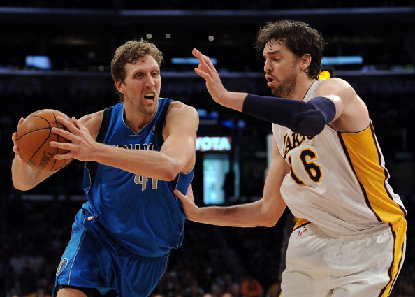 LOS ANGELES, CA - APRIL 15:  Dirk Nowitzki #41 of the Dallas Mavericks drives on Pau Gasol #16 of the Los Angeles Lakers during a 112-108 Laker overtime win at Staples Center on April 15, 2012 in Los Angeles, California.  NOTE TO USER: User expressly acknowledges and agrees that, by downloading and or using this photograph, User is consenting to the terms and conditions of the Getty Images License Agreement.  (Photo by Harry How/Getty Images)