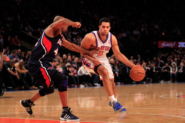 NEW YORK, NY - FEBRUARY 22:  Landry Fields #2 of the New York Knicks drives against Jerry Stackhouse #42 of the Atlanta Hawks at Madison Square Garden on February 22, 2012 in New York City. NOTE TO USER: User expressly acknowledges and agrees that, by downloading and/or using this Photograph, user is consenting to the terms and conditions of the Getty Images License Agreement.  (Photo by Chris Trotman/Getty Images)