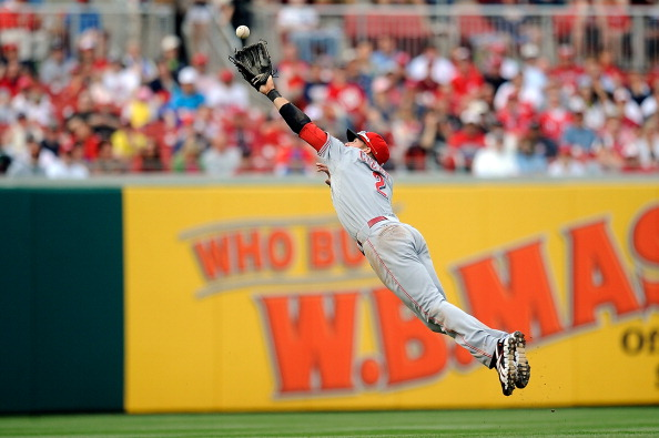 WASHINGTON, DC - APRIL 14:  Zack Cozart #2 of the Cincinnati Reds leaps for a ball during a game against the Washington Nationals at Nationals Park on April 14, 2012 in Washington, DC.  (Photo by Patrick McDermott/Getty Images)