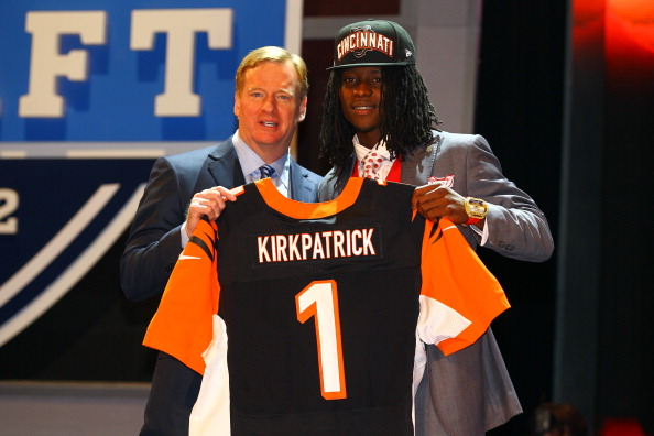 NEW YORK, NY - APRIL 26:  Dre Kirkpatrick (R) of Alabama holds up a jersey as he stands on stage with NFL Commissioner Roger Goodell after he was selected #17 overall by the Cincinnati Bengals in the first round of during the 2012 NFL Draft at Radio City Music Hall on April 26, 2012 in New York City.  (Photo by Al Bello/Getty Images)