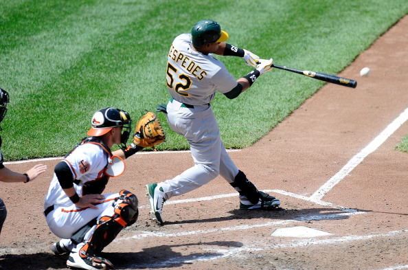 BALTIMORE, MD - APRIL 29:  Yoenis Cespedes #52 of the Oakland Athletics hits a double in the sixth inning against the Baltimore Orioles at Oriole Park at Camden Yards on April 29, 2012 in Baltimore, Maryland.  (Photo by Greg Fiume/Getty Images)