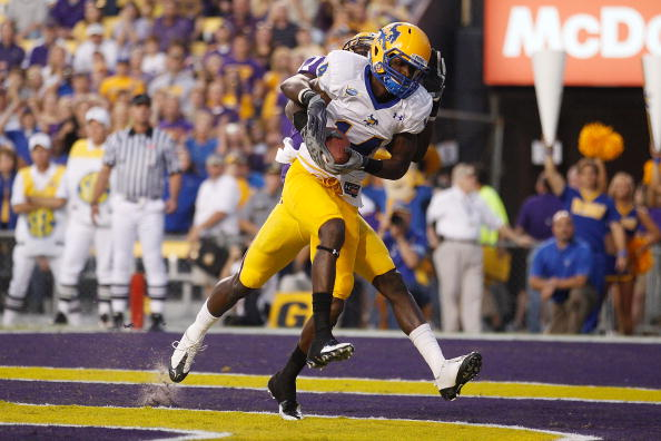 BATON ROUGE, LA - OCTOBER 16:  Damion Dixon #14 of the McNeese State Cowboys catches a touchdown pass over Morris Claiborne #17 of the Louisiana State University Tigers at Tiger Stadium on October 16, 2010 in Baton Rouge, Louisiana.  (Photo by Chris Graythen/Getty Images)