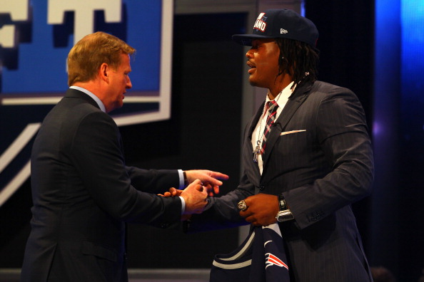 NEW YORK, NY - APRIL 26:  Dont'a Hightower of Alabama greets NFL Commissioner Roger Goodell after he was selected #25 overall by the New England Patriots in the first round of the 2012 NFL Draft at Radio City Music Hall on April 26, 2012 in New York City.  (Photo by Al Bello/Getty Images)