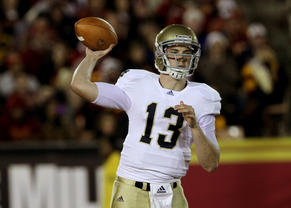 LOS ANGELES - NOVEMBER 27:  Quarterback Tommy Rees #13 of the Notre Dame Fighting Irish throws a pass against the USC Trojans at the Los Angeles Memorial Coliseum on November 27, 2010 in Los Angeles, California.   (Photo by Stephen Dunn/Getty Images)