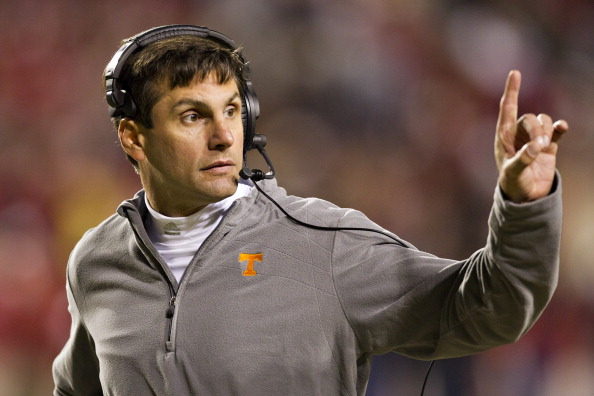 FAYETTEVILLE, AR - NOVEMBER 12:   Head Coach Derek Dooley of the Tennessee Volunteers signals to the sidelines during a game against the Arkansas Razorbacks at Donald W. Reynolds Stadium Stadium on November 12, 2011 in Fayetteville, Arkansas.  The Razorbacks defeated the Volunteers 49 to 7.  (Photo by Wesley Hitt/Getty Images)