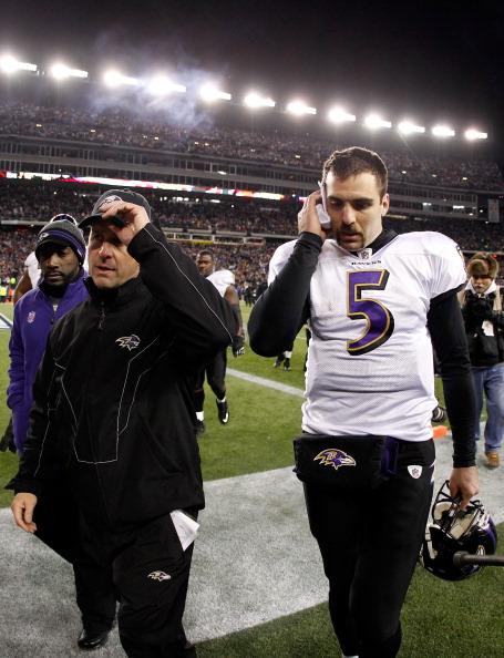 FOXBORO, MA - JANUARY 22:  Joe Flacco #5 of the Baltimore Ravens and head coach John Harbaugh walk off the field after losing to the New England Patriots in the AFC Championship Game at Gillette Stadium on January 22, 2012 in Foxboro, Massachusetts. The New England Patriots defeated the Baltimore Ravens 20-23.  (Photo by Rob Carr/Getty Images)