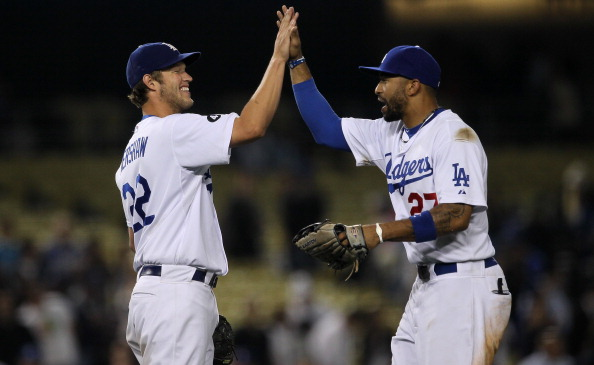 LOS ANGELES, CA - JUNE 20:  Starting pitcher Clayton Kershaw #22 and center fielder Matt Kemp #27 of the Los Angeles Dodgers celebrate after Kershaw's complete game shoutout against the Detroit Tigers on June 20, 2011 at Dodger Stadium in Los Angeles, California.  The Dodgers won 4-0.  (Photo by Stephen Dunn/Getty Images)