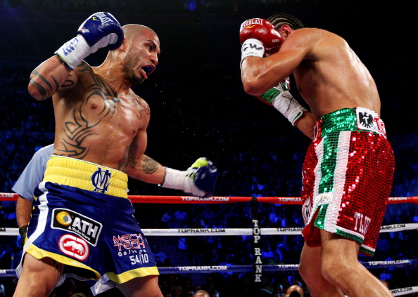 NEW YORK, NY - DECEMBER 03:  Miguel Cotto of Puerto Rico throws a left handed punch against Antonio Margarito of Mexico during the WBA World Junior Middleweight Title fight at Madison Square Garden on December 3, 2011 in New York City.  (Photo by Al Bello/Getty Images)