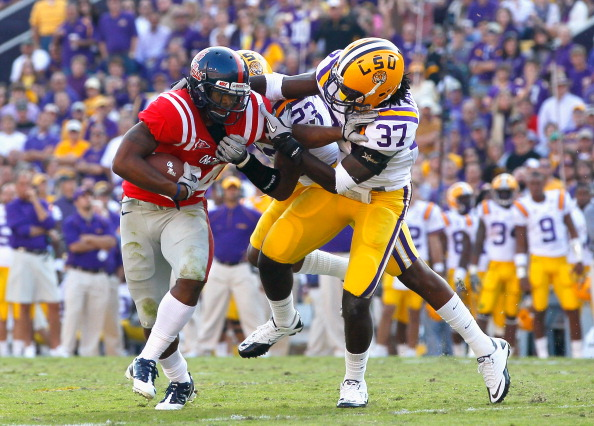 BATON ROUGE, LA - NOVEMBER 20:  Stefoin Francois #23 and Karnell Hatcher #37 of the Louisiana State University Tigers tackle Brandon Bolden #34 of the Ole Miss Rebels at Tiger Stadium on November 20, 2010 in Baton Rouge, Louisiana.  (Photo by Kevin C. Cox/Getty Images)