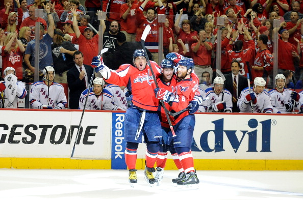 WASHINGTON, DC - MAY 05: Mike Green #52 of the Washington Capitals celebrates with Alex Ovechkin #8 and Dennis Wideman #6 after scoring the game winning goal in the third period against the New York Rangers in Game Four of the Eastern Conference Semifinals during the 2012 NHL Stanley Cup Playoffs at the Verizon Center on May 5, 2012 in Washington, DC. Washington won the game 3-2. (Photo by Greg Fiume/Getty Images)