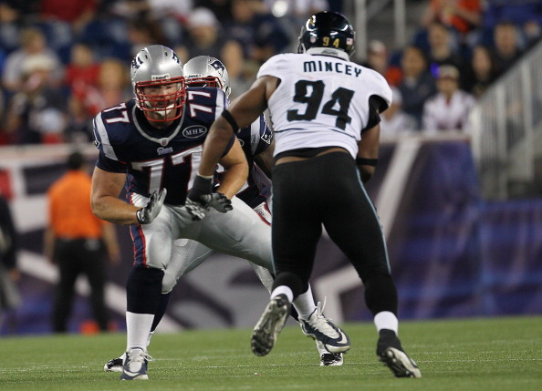 FOXBORO, MA - AUGUST 11:  Nate Solder #77 of the New England Patriots battles Jeremy Mincey #94 of the Jacksonville Jaguars during a preseason game at Gillette Stadium on August 11, 2011 in Foxboro, Massachusetts. (Photo by Jim Rogash/Getty Images)