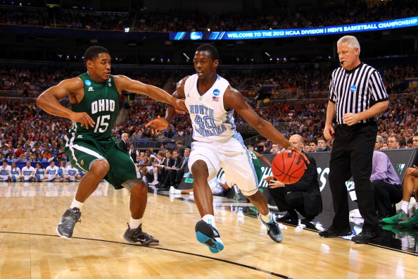 ST. LOUIS, MO - MARCH 23:  Harrison Barnes #40 of the North Carolina Tar Heels drives in the first half against Nick Kellogg #15 of the Ohio Bobcats during the 2012 NCAA Men's Basketball Midwest Regional Semifinal at Edward Jones Dome on March 23, 2012 in St. Louis, Missouri.  (Photo by Dilip Vishwanat/Getty Images)