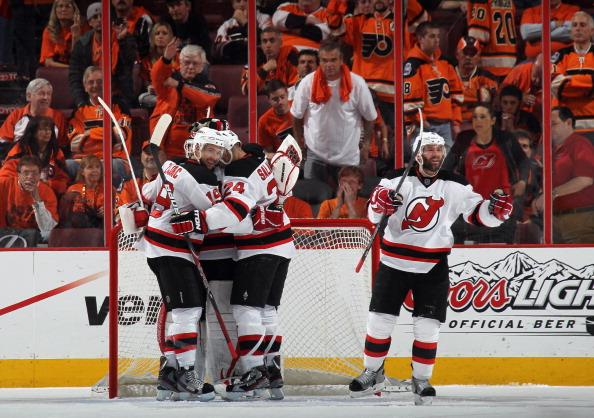 PHILADELPHIA, PA - MAY 08: (L-R) Travis Zajac #19, Martin Brodeur #30, Bryce Salvador #24 and Andy Greene #6 of the New Jersey Devils celebrate their 3-1 victory over the Philadelphia Flyers in Game Five of the Eastern Conference Semifinals during the 2012 NHL Stanley Cup Playoffs at Wells Fargo Center on May 8, 2012 in Philadelphia, Pennsylvania. The Devils defeated the Flyers 3-1 to win the series four games to one. (Photo by Bruce Bennett/Getty Images)