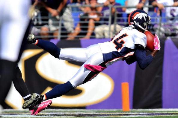 BALTIMORE, MD - OCTOBER 10:  Brandon Lloyd #84 of the Denver Broncos scores a touchdown against the Baltimore Ravens at M&T Bank Stadium on October 10, 2010 in Baltimore, Maryland. Players wore pink in recognition of Breast Cancer Awareness Month. The Ravens lead the Broncos at the half 17-7. (Photo by Larry French/Getty Images)