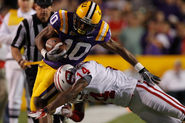 BATON ROUGE, LA - NOVEMBER 12:  Russell Shepard #10 of the Louisiana State University Tigers is tackled by Kareem Peterson #14 of the Western Kentucky Hilltoppers at Tiger Stadium on November 12, 2011 in Baton Rouge, Louisiana.  (Photo by Chris Graythen/Getty Images)