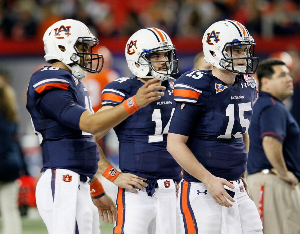 ATLANTA, GA - DECEMBER 31:  Clint Moseley #15, Barrett Trotter #14 and Kiehl Frazier #10 of the Auburn Tigers against the Virginia Cavaliers during the 2011 Chick Fil-A Bowl at Georgia Dome on December 31, 2011 in Atlanta, Georgia.  (Photo by Kevin C. Cox/Getty Images)