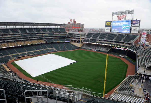 MINNEAPOLIS, MN - APRIL 28: A general view of Target Field while the tarp is on the field as rain delays the start of the game between the Minnesota Twins and the Kansas City Royals on April 28, 2012 in Minneapolis, Minnesota. (Photo by Hannah Foslien/Getty Images)