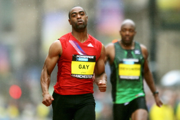 MANCHESTER, ENGLAND - MAY 15:  Tyson Gay of USA powers ahead and wins his 150m race against Darvis Patton of USA, Marlon Devonish of Great Britain and Christian Malcolm of Great Britain during the Powerade Great City Games on May 15, 2011 in Manchester, England.  (Photo by Dean Mouhtaropoulos/Getty Images)