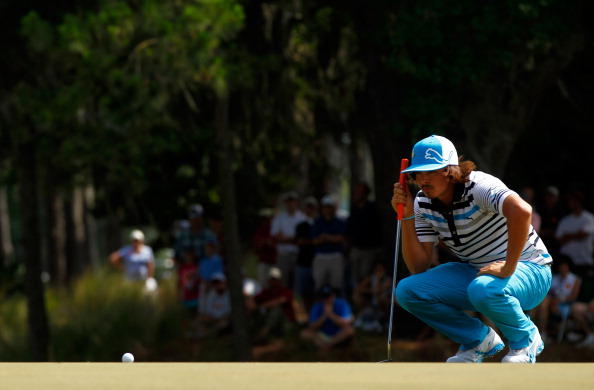 PONTE VEDRA BEACH, FL - MAY 12: Rickie Fowler of the United States lines up a putt on the 15th green during the third round of THE PLAYERS Championship held at THE PLAYERS Stadium course at TPC Sawgrass on May 12, 2012 in Ponte Vedra Beach, Florida.  (Photo by Mike Ehrmann/Getty Images)