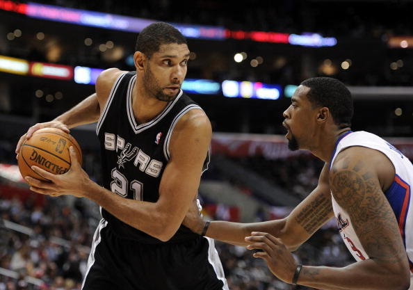 LOS ANGELES, CA - DECEMBER 01:  Tim Duncan #21 of the San Antonio Spurs pauses with the ball in front of DeAndre Jordan #9 of the Los Angeles Clippers at the Staples Center on December 1, 2010 in Los Angeles, California.  NOTE TO USER: User expressly acknowledges and agrees that, by downloading and or using this photograph, User is consenting to the terms and conditions of the Getty Images License Agreement.  (Photo by Harry How/Getty Images)