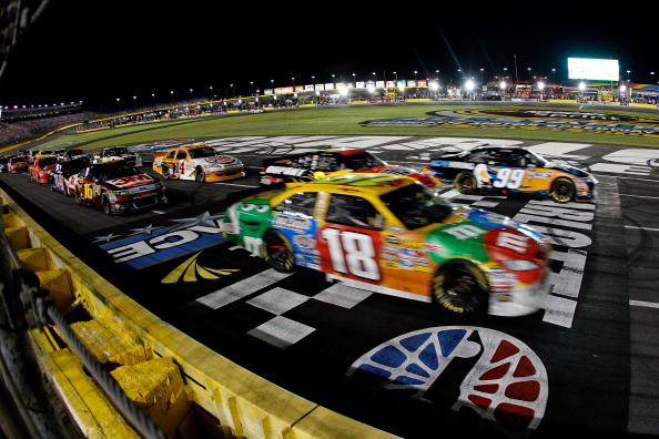 CHARLOTTE, NC - MAY 21:  Carl Edwards, driver of the #99 Aflac Ford, and Kyle Busch, driver of the #18 M&M's Toyota, race against each other during the NASCAR Sprint All-Star Race at Charlotte Motor Speedway on May 21, 2011 in Charlotte, North Carolina.  (Photo by Pool/Getty Images for NASCAR)