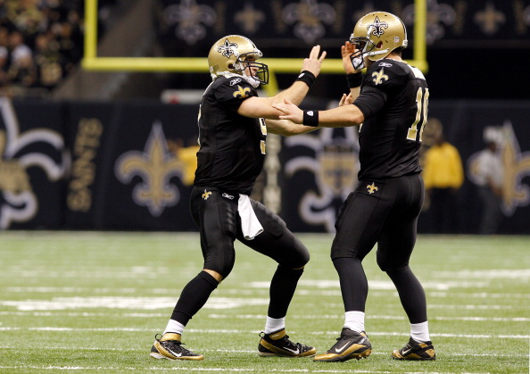 NEW ORLEANS, LA - DECEMBER 26:  Quarterback Drew Brees #9 of the New Orleans Saints reacts with quarterback Chase Daniel #10 in the first half against the Atlanta Falcons at the Mercedes-Benz Superdome on December 26, 2011 in New Orleans, Louisiana.  (Photo by Chris Graythen/Getty Images)