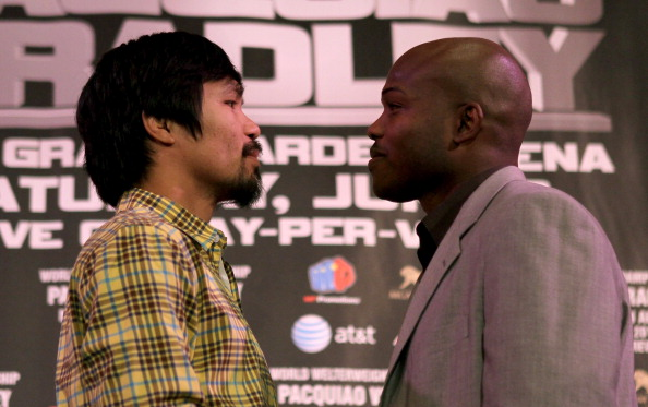 BEVERLY HILLS, CA - FEBRUARY 21:  Manny Pacquiao (L) and Timothy Bradley pose for photographers at a press conference announcing their upcoming World Boxing Organization welterweight championship fight at The Beverly Hills Hotel on February 21, 2012 in Beverly Hills, California.  (Photo by Stephen Dunn/Getty Images)