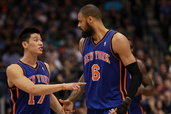 DALLAS, TX - MARCH 06:  Jeremy Lin #17 of the New York Knicks talks with Tyson Chandler during play against the Dallas Mavericks at American Airlines Center on March 6, 2012 in Dallas, Texas.  NOTE TO USER: User expressly acknowledges and agrees that, by downloading and or using this photograph, User is consenting to the terms and conditions of the Getty Images License Agreement.  (Photo by Ronald Martinez/Getty Images)
