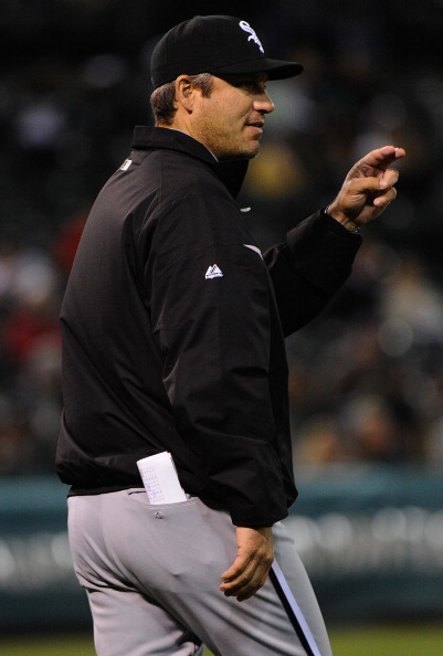 OAKLAND, CA - APRIL 24:  Manager Robin Ventura of the Chicago White Sox makes the call to the bullpen against the Oakland Athletics in the eighth inning at O.co Coliseum on April 24, 2012 in Oakland, California. The Athletics won the game 2-0.  (Photo by Thearon W. Henderson/Getty Images)