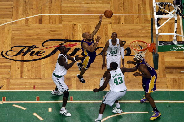 BOSTON - JUNE 08:  Derek Fisher #2 of the Los Angeles Lakers puts a shot up over Kevin Garnett #5, Ray Allen #20  and Kendrick Perkins #43 of the Boston Celtics in Game Three of the 2010 NBA Finals on June 8, 2010 at TD Garden in Boston, Massachusetts. NOTE TO USER: User expressly acknowledges and agrees that, by downloading and/or using this Photograph, user is consenting to the terms and conditions of the Getty Images License Agreement.  (Photo by Jim Rogash/Getty Images)