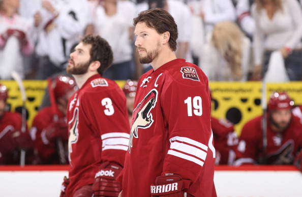 GLENDALE, AZ - MAY 15:  Shane Doan #19 and Keith Yandle #3 of the Phoenix Coyotes look on during the singing of the National Anthem prior to Game Two of the Western Conference Final against the Los Angeles Kings during the 2012 NHL Stanley Cup Playoffs at Jobing.com Arena on May 15, 2012 in Phoenix, Arizona.  (Photo by Christian Petersen/Getty Images)