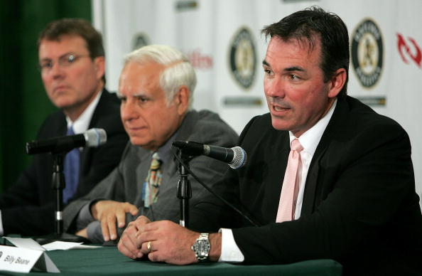 OAKLAND, CA - APRIL 1:  Oakland Athletics Vice President and General Manager Billy Beane (R) speaks during a news conference as Lewis Wolff, new co-owner and managing partner of the Athletics and Michael Crowley, (R) Athletics President look on  April 1, 2005 in Oakland, California. Major League Baseball approved the sale of the Athletics on March 30th to a group headed by Wolff which includes his son, Keith Wolff, and billionaire John Fisher, son of Gap founder Donald Fisher.  (Photo by Justin Sullivan/Getty Images)