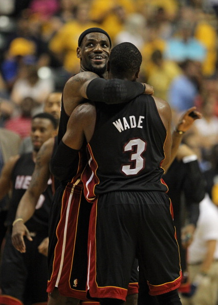 INDIANAPOLIS, IN - MAY 20:  LeBron James #6 of the Miami Heat hugs teammate Dwyane Wade #3 near the end of a win over the Indiana Pacers in Game Four of the Eastern Conference Semifinals in the 2012 NBA Playoffs at Bankers Life Fieldhouse on May 20, 2012 in Indianapolis, Indiana. The Heat defeated the Pacers 101-93. NOTE TO USER: User expressly acknowledges and agrees that, by downloading and/or using this photograph, User is consenting to the terms and conditions of the Getty Images License Agreement.  (Photo by Jonathan Daniel/Getty Images)