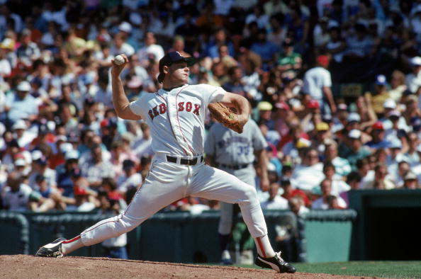 BOSTON, MA - 1987:  Roger Clemens #21 of the Boston Red Sox pitches against the Seattle Mariners during a game in the 1987 MLB Season at Fenway Park in Boston, Massachusetts. (Photo by Rick Stewart/Getty Images)