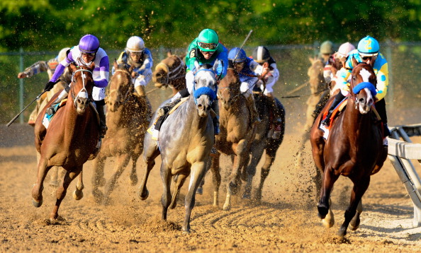 BALTIMORE, MD - MAY 19:  Jockey Mike Smith aboard Bodemeister (R) leads the field and jockey Mario Gutierrez on I'll Have Another (L) out of the fourth turn during the 137th Preakness Stakes at Pimlico Race Course on May 19, 2012 in Baltimore, Maryland.  (Photo by Tyler Carr/Getty Images)